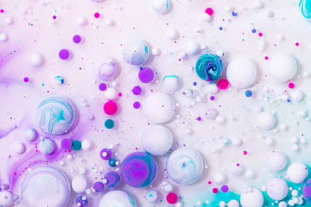 Fluid art texture. Abstract backdrop with iridescent paint effect. Liquid acrylic artwork that flowing bubbles. Mixed paints for website background. White, purple and pink overflowing colors