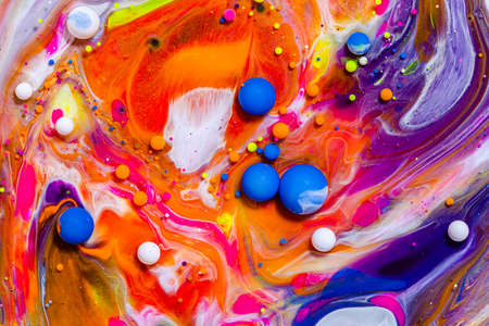 Fluid art texture. Background with abstract swirling paint effect. Liquid acrylic picture with flowing bubbles. Mixed paints for posters or wallpapers. Vibrant overflowing colors