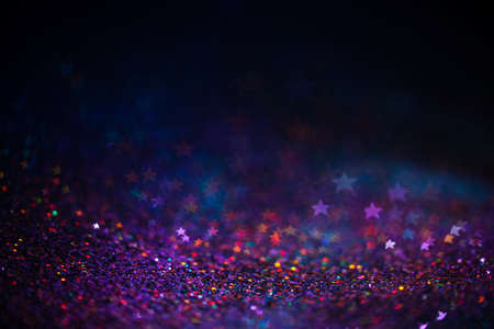 Decoration bokeh lights background, abstract blurred backdrop with stars, modern design wallpaper with sparkling glimmers. Purple, blue and pink backdrop glittering sparks with blur effect