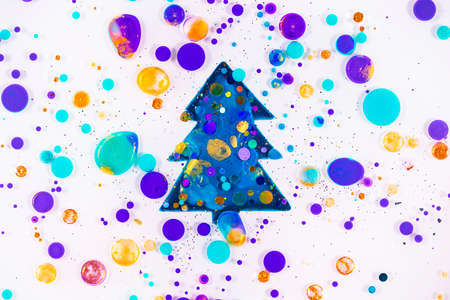 Fluid art texture. Abstract new year background. Liquid acrylic artwork with flowing bubbles. Mixed paints for backdrop or poster. Christmas tree. Overflowing colors with glitters