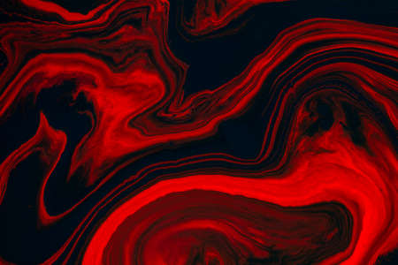 Fluid art texture. Abstract background with swirling paint effect. Liquid acrylic picture that flows and splashes. Mixed paints for baner or wallpaper. Black, red and orange overflowing colors