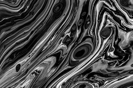Fluid art texture. Abstract backdrop with iridescent paint effect. Liquid acrylic picture with chaotic mixed paints. Can be used for posters or wallpapers. Black and white overflowing colors. Stock fotó