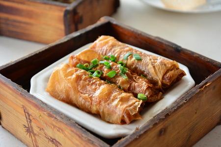 curd: Bamboo steamer bean curd rolls Stock Photo