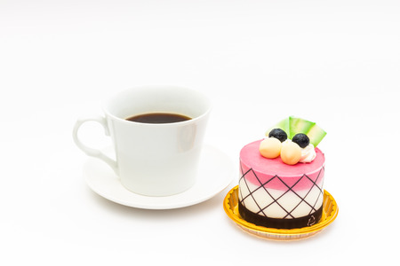 blueberry cupcake with black coffee in white coffee mug on white background photo