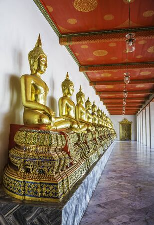 transcendental: Golden buddha in Wat Pho Temple sequential nicely in Bangkok, Thailand