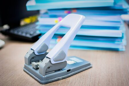 paper hole: Hole puncher. Office paper hole puncher on desk