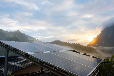 Power plant using renewable solar energy with sunset over the Gap in the Great Smoky Mountains background Standard-Bild