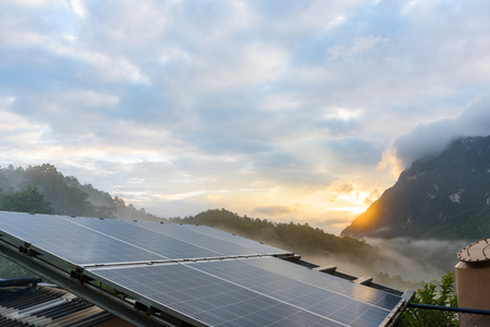 solar collector: Power plant using renewable solar energy with sunset over the Gap in the Great Smoky Mountains background Stock Photo