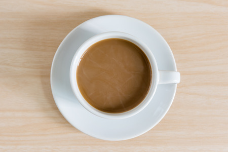 tabular: top view of coffee cup on wooden background Stock Photo