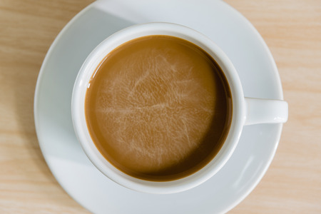 inexpressive: top view of coffee cup on wooden background Stock Photo