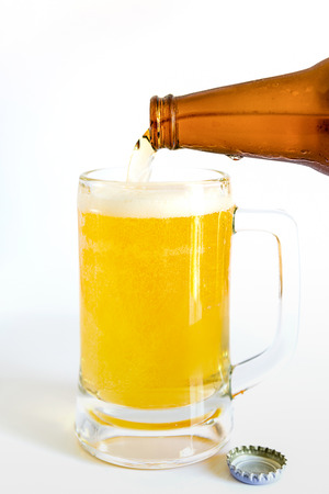 refreshment: Close up of bottle of beer pouring into a glass, Cold refreshment