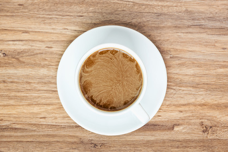 inexpressive: top view of coffee white cup on wooden background Stock Photo