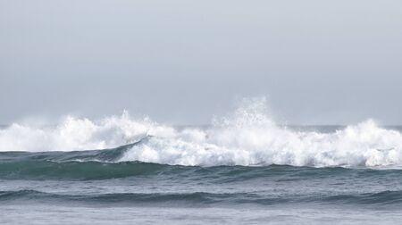 breaking: Breaking huge waves at the seashore