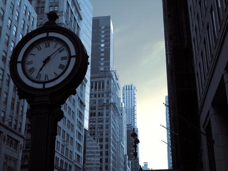 A big clock on Manhattan street.