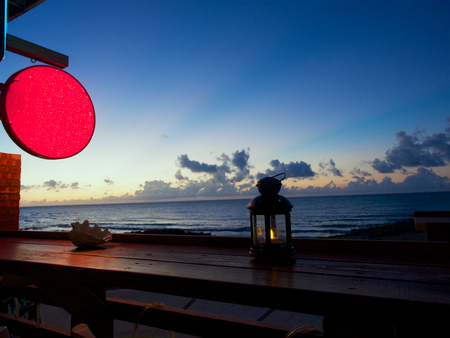 Qianshuiwan Sanzhi,New Taipei city.Wait to see sunset at coffee shop. Stock Photo