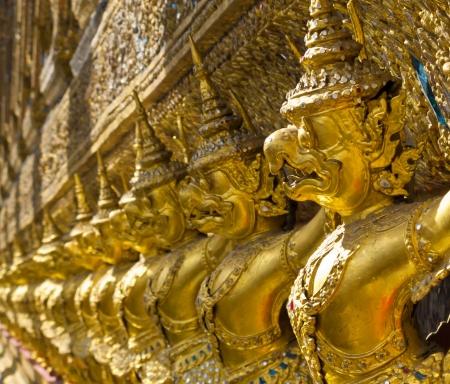 Golden garuda on the wall of wat Phra kaew, Thailand photo
