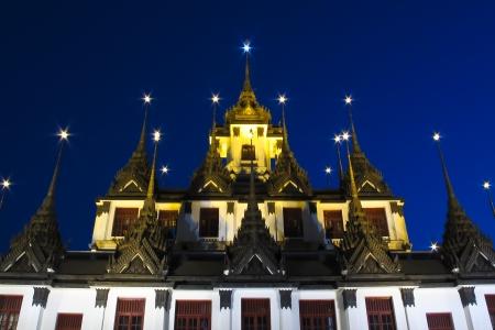 The Loha Prasat with twilight time at wat Ratchanadda, Bangkok, Thailand photo