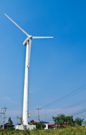 Wind turbine with blue sky background photo