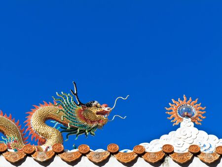 Chinese dragon and sculpture of the sun with blue sky Stock Photo - 17358668