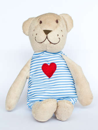 Bear doll with heart on white back ground photo