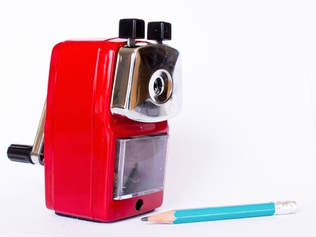 hand crank: Red sharpener and green pencil on white background