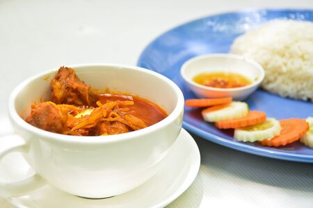 tast: Curry with rice and slice carrot