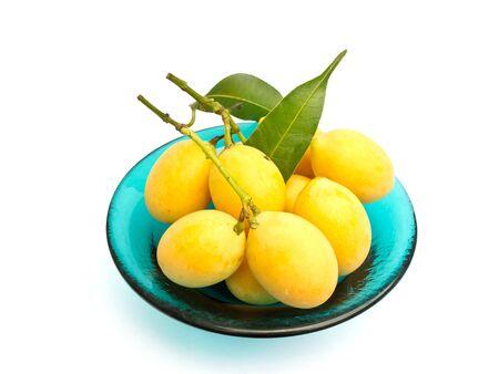 tast: The Marian plum fruit on the green dish Stock Photo