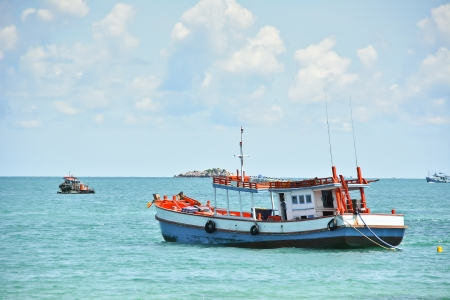 fisherman on boat: Fishing boat on the sea
