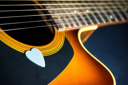 country music: Acoustic guitar with blue pick