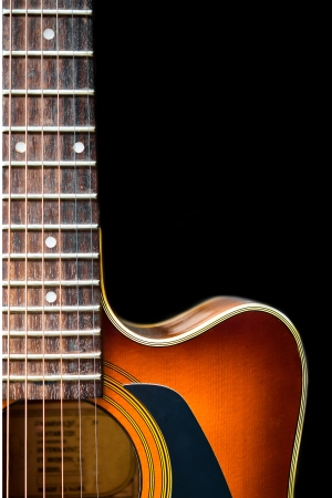 Acoustic guitar isolated on black photo