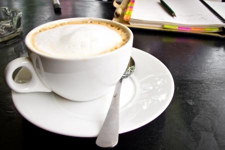 capuchino coffee with notebook photo