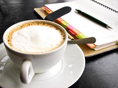 capuchino: capuchino coffee with notebook Stock Photo