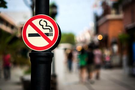 No smoking sign pole