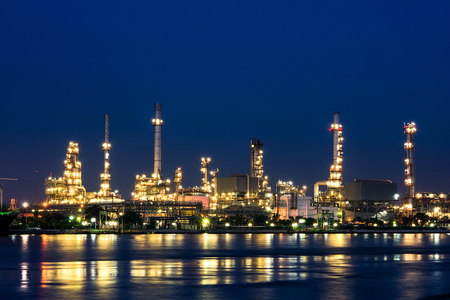 Oil refinery plant at twilight time photo