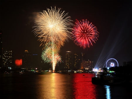 Fireworks display in the city as for celebrating New Year Stock Photo
