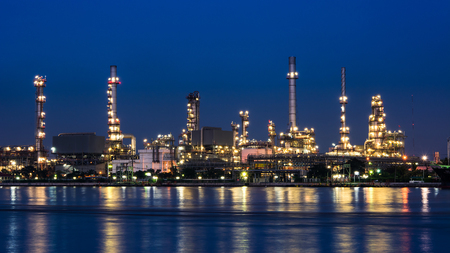 Oil and gas refinery plant at night time