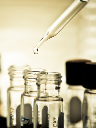 lighting technician: Dropping liquid to test tube, Laboratory