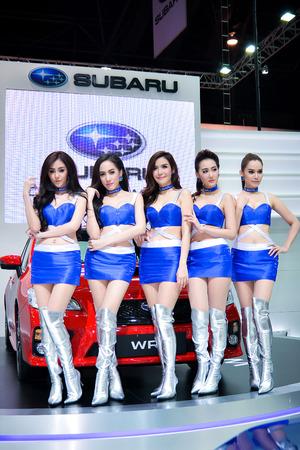 subaru: BANGKOK - MARCH 28 Unidentified model with Subaru on display at The 35th Bangkok International Motor Show on March 28, 2014 in Bangkok, Thailand