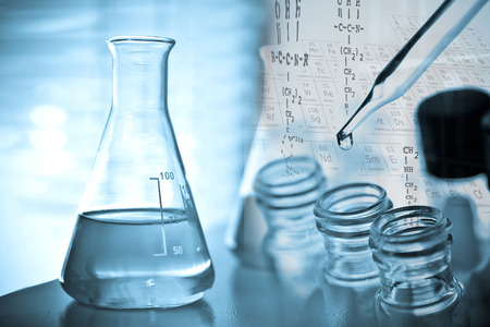 Laboratory research, dropping liquid to test tube