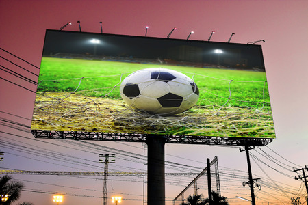 Football in the field display on billboard photo