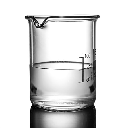Beaker containing chemical liquid on white background