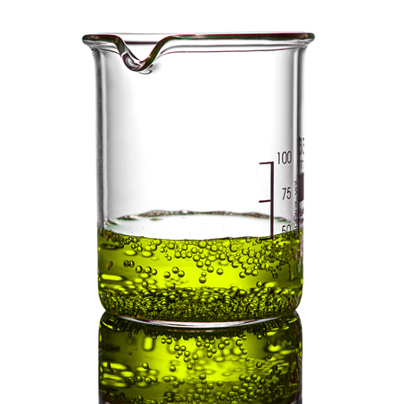 Beaker containing chemical liquid on white background