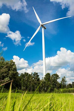 wind turbine with blue sky, renewable energy photo