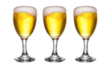 unbottled: Beer with foam in glass isolated on white