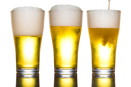 Beer with foam in glass isolated on white