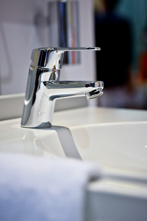 luxury bathroom: Modern faucet and wash basin in luxury bathroom