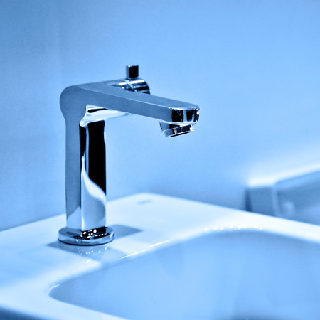 Modern faucet and wash basin in luxury bathroom