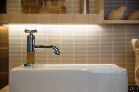 wash basin and faucet in luxury bathroom Stock Photo