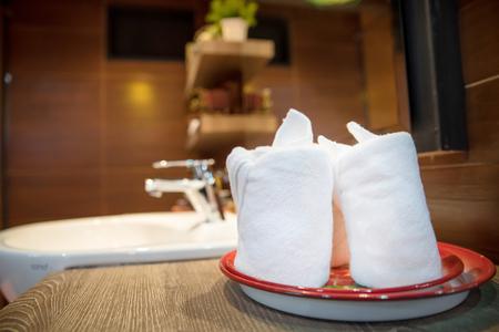 luxury bathroom: wash basin and towel in luxury bathroom