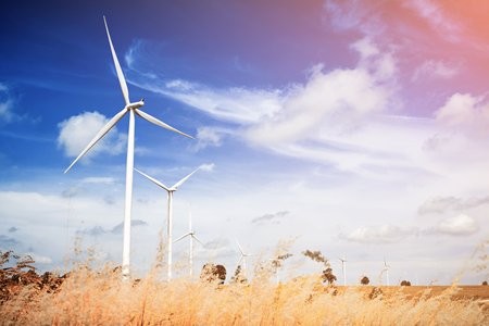 farm equipment: Wind turbine with blue sky, renewable energy Stock Photo